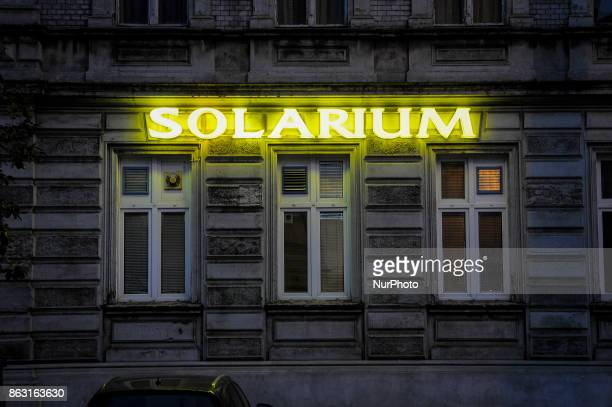Neon letters advertising a tanning salon in the center of the city are seen on 19 October 2017