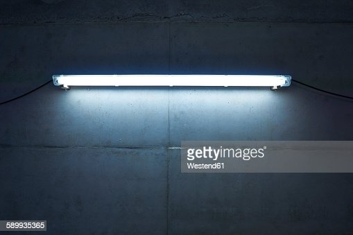 Neon light at concrete wall