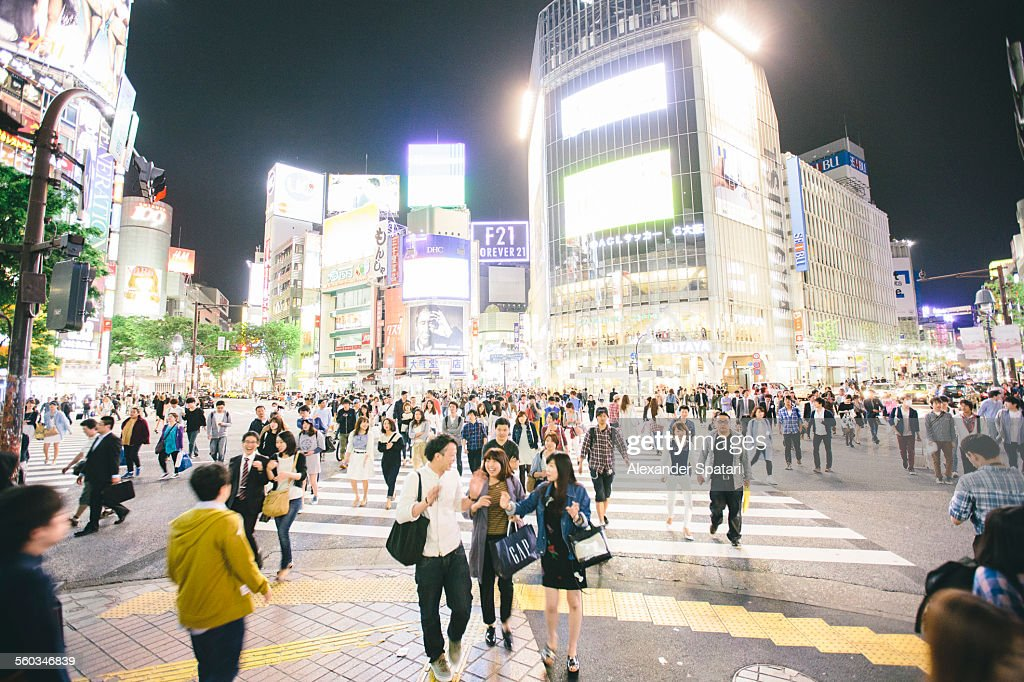 Neon lights and crowds of people in Shibuya, Tokyo