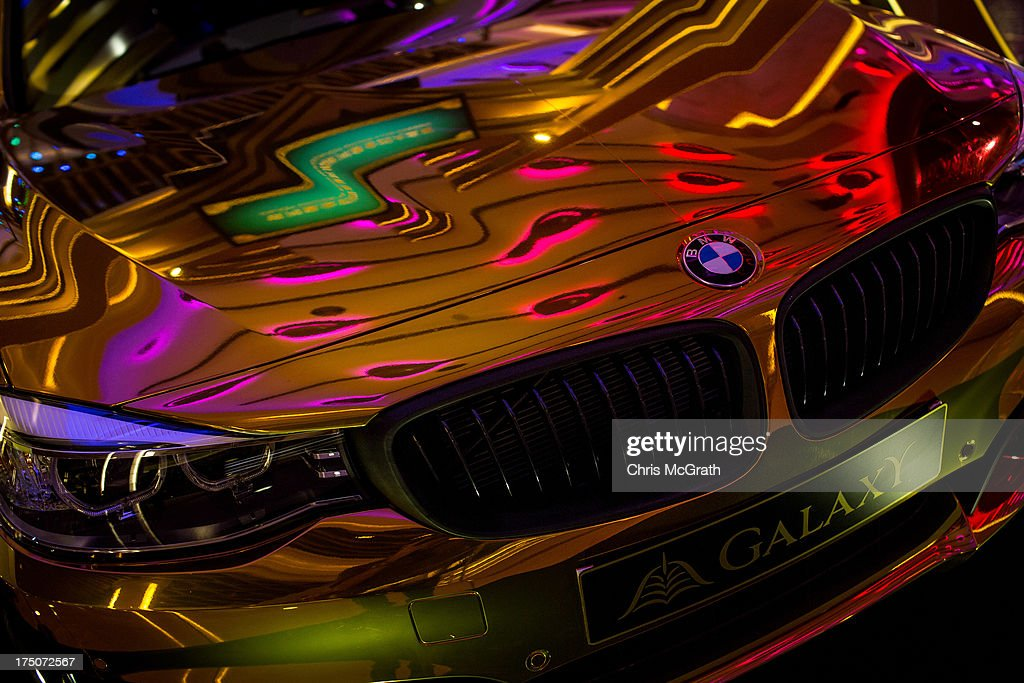 Neon lights are seen reflected in a gold BMW car on show in the lobby of the Galaxy Casino and Hotel complex on July 29, 2013 in Macau, Macau. Macau, the only place in China with legalized casino gambling is booming. Gambling has been legal in Macau for more than 150 years but has seen a rapid transformation over the last decade from the small time gambling clubs, gangs and prostitution of the 1990s, to becoming the worlds gambling mecca. Last year, Macau generated $38 billion in casino revenue, six times more than Las Vegas, Nevada. Situated just one hour from mainland China and Hong Kong, Macau also known as 'The Oriental Las Vegas ' received 14.1million visitors for the first six months of this year, in the most recent Statistics and Census Bureau report, with close to 90% of visitors being from mainland China, Taiwan and Hong Kong. Although the gambling industry has improved general living standards across Macau, it is not without it's downside. With the influx of big money also comes, higher living costs, with some residents saying issues such as transportation, health care and social welfare have largely been ignored. Property prices have increased dramatically, forcing many small and mid-sized businesses into bankruptcy and pushing some residents to share accommodation or move away completely.