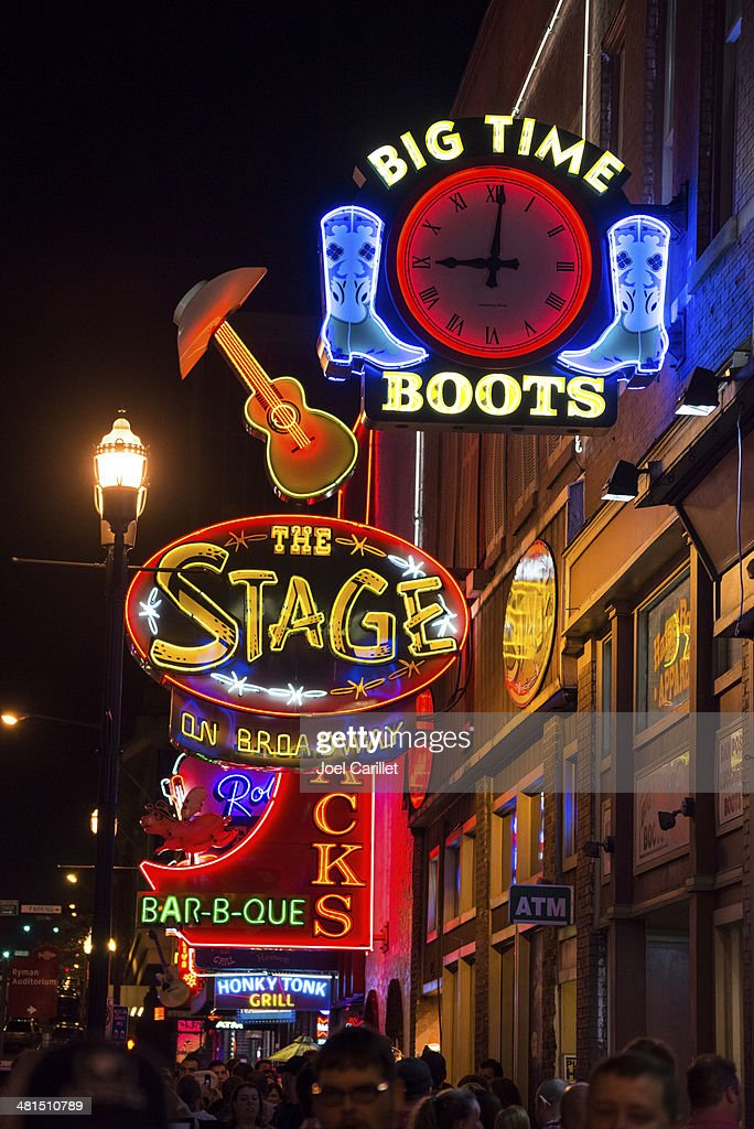 Neon lights on Broadway at night in Nashville, Tennessee : Stock Photo