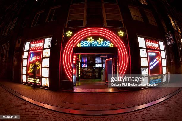 Neon lit sex club in red light district, Amsterdam, Netherlands
