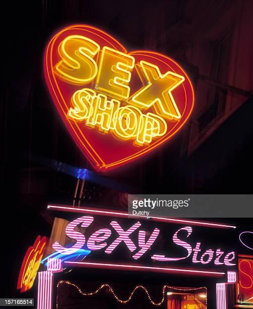 A neon lit sign of a sex shop in Pigalle, Paris