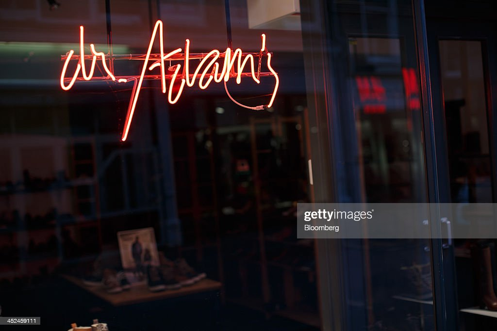 A neon logo sits on display in the window of a Dr. Adam's footwear store in Utrecht, Netherlands, on Friday, Nov. 29, 2013. European government bonds were little changed as investors showed a muted reaction to Standard & Poor's decision to raise its outlook on Spain's debt and strip the Netherlands of its top credit rating. Photographer: Jasper Juinen/Bloomberg via Getty Images
