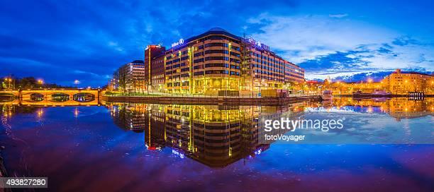 Neon night city lake reflection apartments hotels shops Helsinki Finland