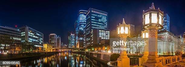 Neon night futuristic cityscape panorama illuminated lamplight Osaka Japan