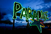 Neon Paradise Sign on Acapulco Beach
