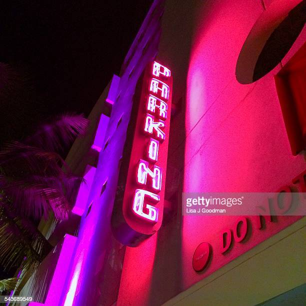 Neon Parking Sign And Palm Tree In Art Deco District In Miami Florida On