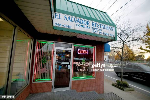 A neon sign advertises regional food for an El Salvadoranowned restaurant along a main thoroughfare on eastern Long Island December 1 2005 in Central...