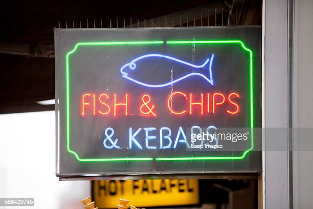 A neon sign for fish and chips and kebabs on Oxford Street