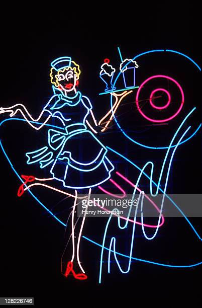 Neon sign of waitress serving ice cream