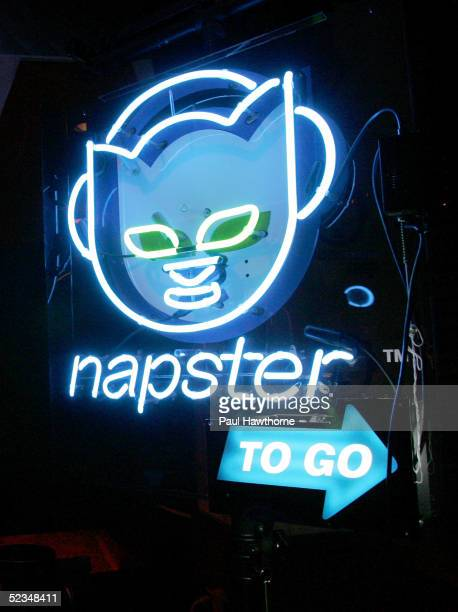 A neon sign shows people the way to their free MP3 player as they attend the 'Napster To Go Cafe' at the Coffee Shop on Union Square March 9 2005 in...