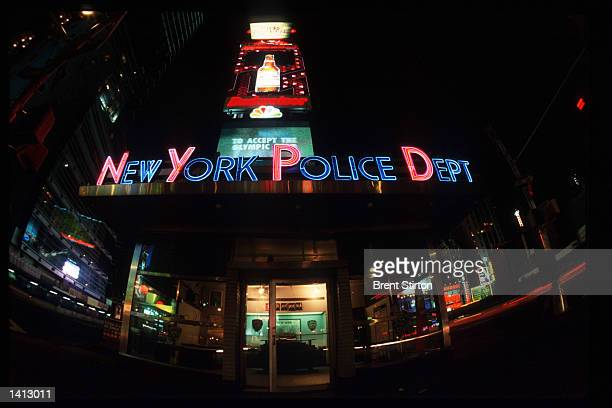 A neon sign sits atop the Police Department building in Times Square November 15 1999 in New York City The Times Square area is undergoing a thorough...