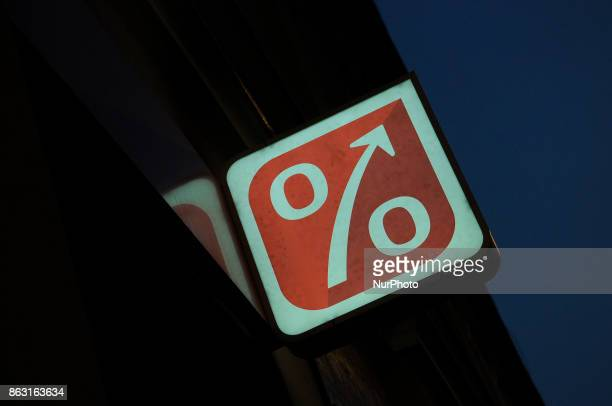 A neon sign with a mark resembling a percentage symbol is seen in the center of the city on 19 October 2017