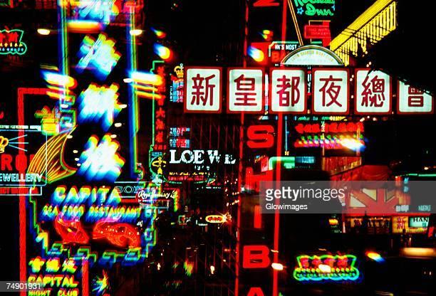 Neon signboards lit up at night, Hong Kong, China