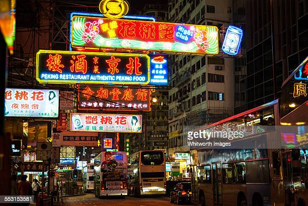 Neon signs and buses on crowded Hong Kong streets