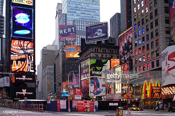 Neon signs and pedestrians Midtown Manhattan New York Broadway Times Square United States