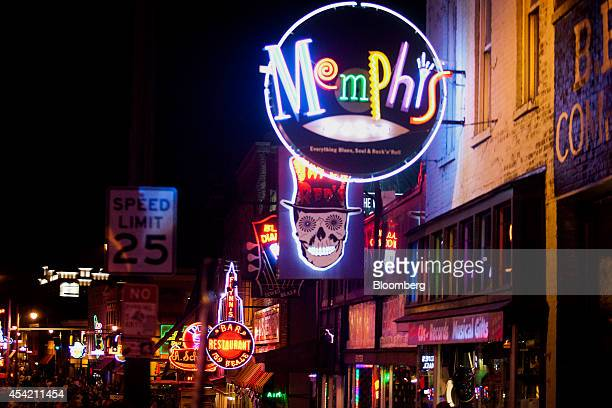 Neon signs for bars and clubs light up Beale Street at night in downtown Memphis Tennessee US on Saturday Aug 16 2014 The US Bureau of Economic...