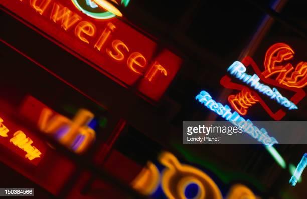 Neon signs light up City Walk at Universal Studios in Burbank.
