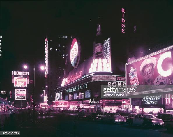 Neon signs on Times Square New York City at night 1956
