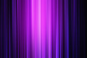 neon light background image containing multi coloured pinks and purples with a bright centre and dark areas for copy space. the lines of blur have been accentuated in post production with a subtle gra