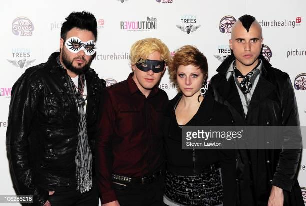 Neon Trees bassist Branden Campbell guitarist Chris Allen drummer Elaine Bradley and frontman Tyler Glenn arrive at a charity masquerade ball...