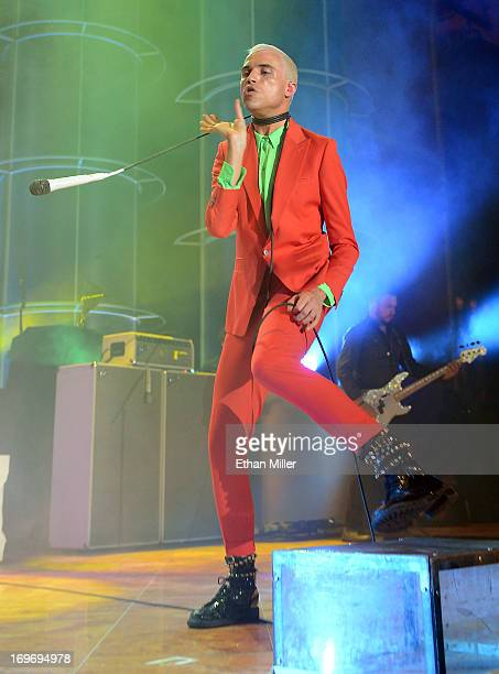 Neon Trees frontman Tyler Glenn swings a microphone around his neck as he and bassist Branden Campbell perform at the Couture Las Vegas jewelry show...