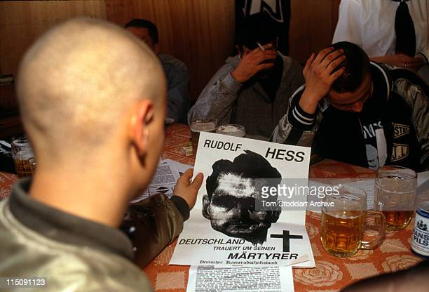 neoNazi followers with Rudolf Hess posters at a drunken rally in Cottbus After German reunification in the early 1990's neoNazi groups flourished...