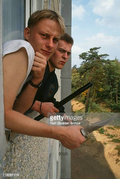 neoNazi followers with weapons in Cottbus After German reunification in the early 1990's neoNazi groups flourished amongst the economic collapse and...