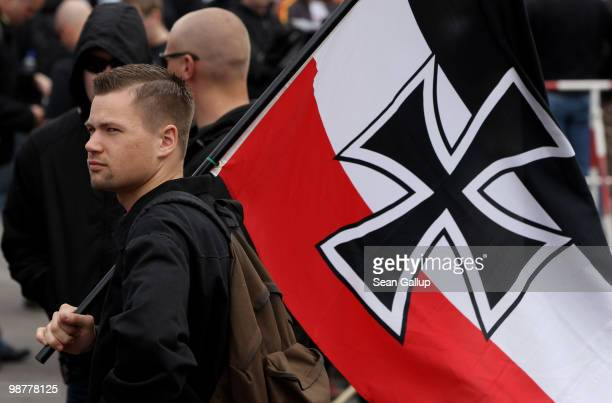 A neoNazi supporter arrives bearing colours of the preWorld War I German Empire at a rally and march on May 1 2010 in Berlin Germany Several hundred...