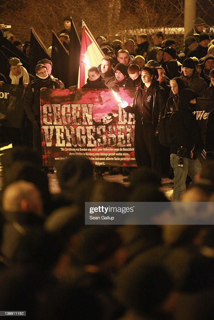Neo-Nazis and their sympathizers gather to commemorate the World War II firebombing of Dresden by Allied planes on February 13, 2012 in Dresden, Germany. Protesters attempted unsuccessfully to surround the expected 1,500 neo-Nazis with a human chain in order to prevent them from marching through the city in the annual event. Right-wing extremism is currently making national headlines in Germany due to the revelation that a pair of neo-Nazis claiming to be part of a group called the National Socialist Underground (NSU) murdered at least 10 immigrant small-business owners as well as a policewoman over a decade-long period, and that police investigations at the time were either botched or willfully aborted.