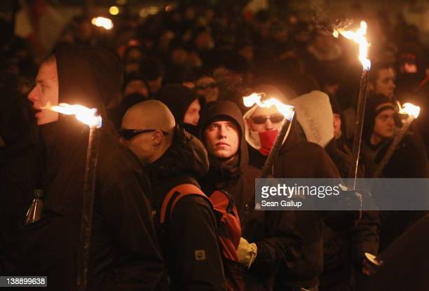 NeoNazis and their sympathizers march with torches to commemorate the World War II firebombing of Dresden by Allied planes on February 13 2012 in...