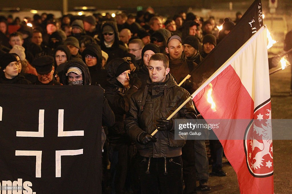 Neo-Nazis and their sympathizers march with torches to commemorate the World War II firebombing of Dresden by Allied planes on February 13, 2012 in Dresden, Germany. Civil rights activists sought to surround the expected 1,500 neo-Nazis with a human chain in order to prevent them from marching through the city in the annual event. Right-wing extremism is currently making national headlines in Germany due to the revelation that a pair of neo-Nazis claiming to be part of a group called the National Socialist Underground (NSU) murdered at least 10 immigrant small-business owners as well as a policewoman over a decade-long period, and that police investigations at the time were either botched or willfully aborted.