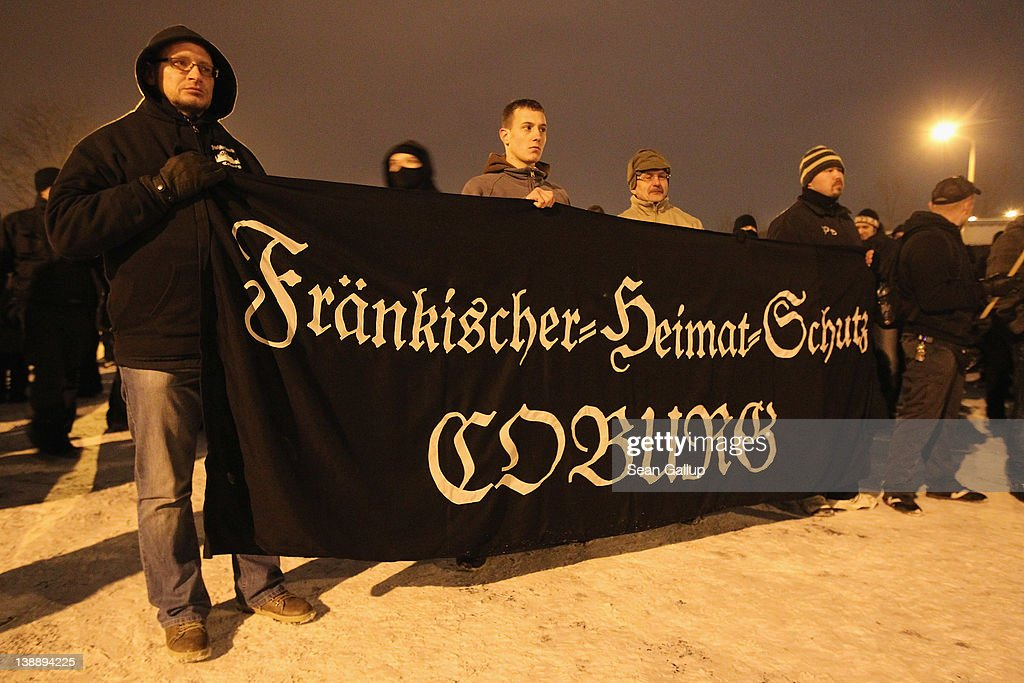 'Frankonian Homeland Defense Coburg' during a march to commemorate the World War II firebombing of Dresden by Allied planes on February 13, 2012 in Dresden, Germany. Protesters attempted unsuccessfully to surround the expected 1,500 neo-Nazis with a human chain in order to prevent them from marching through the city in the annual event. Right-wing extremism is currently making national headlines in Germany due to the revelation that a pair of neo-Nazis claiming to be part of a group called the National Socialist Underground (NSU) murdered at least 10 immigrant small-business owners as well as a policewoman over a decade-long period, and that police investigations at the time were either botched or willfully aborted.