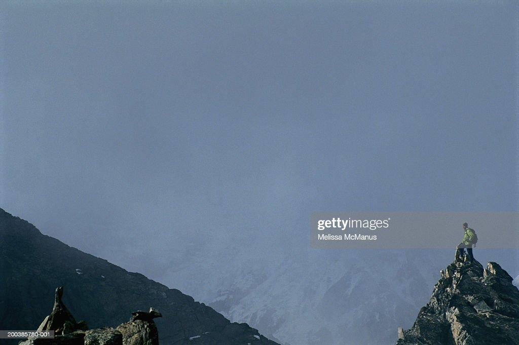 Nepal, Gokyo Ri, male mountainclimber on peak, side view : Stock Photo