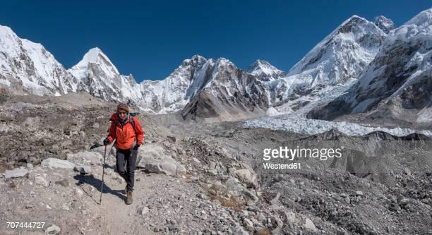 Nepal, Himalaya, Khumbu, Everest region, woman at Everest base camp