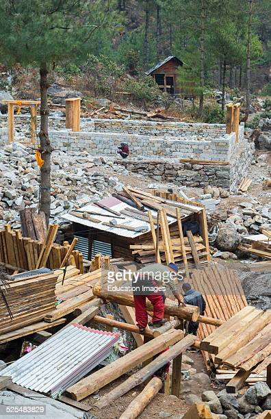 Nepal Himalayas Sherpa men build several houses in the village of Nyanbua Thyang Solukhumbu remote near Mt Everest