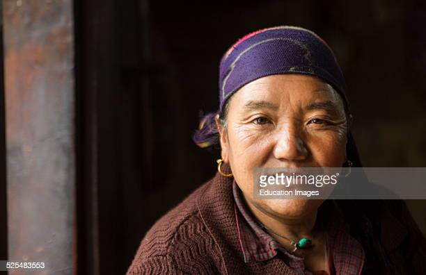 Nepal Himalayas Sherpa woman posing in tea house in the village of Tok Tok Solukhumbu remote Mt Everest