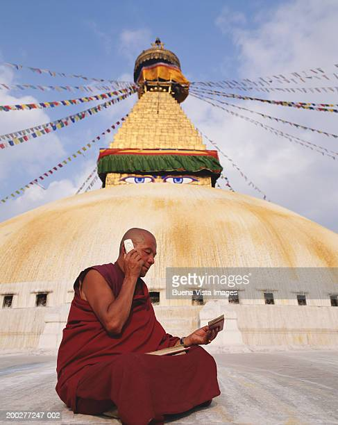 Nepal, Kathmandu, Buddhist monk using mobile phone