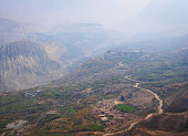 Nepal, Mustang, Jharkot: Hazy spring season view over Himalayan villages and fields