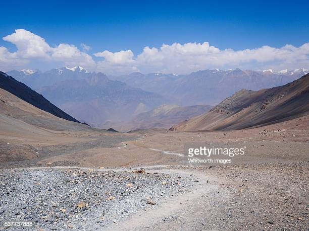 Nepal, Mustang: Path over arid slopes descending from Thorong La Himalayan pass
