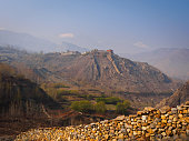 Nepal, Mustang: View to hill-top village over Jharkot