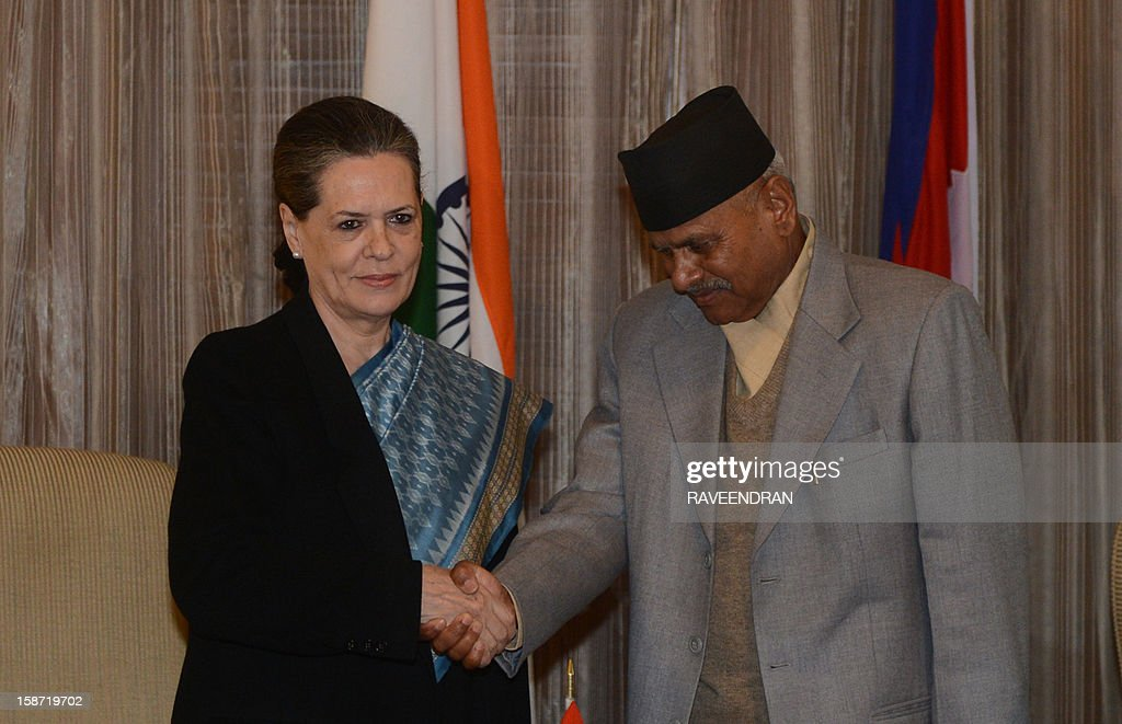 Nepal President Ram Baran Yadav (R) shakes hands with Chairperson of India's UPA Government, Sonia Gandhi during a meeting in New Delhi on December 26, 2012. Yadav is in India for a six-day official visit.