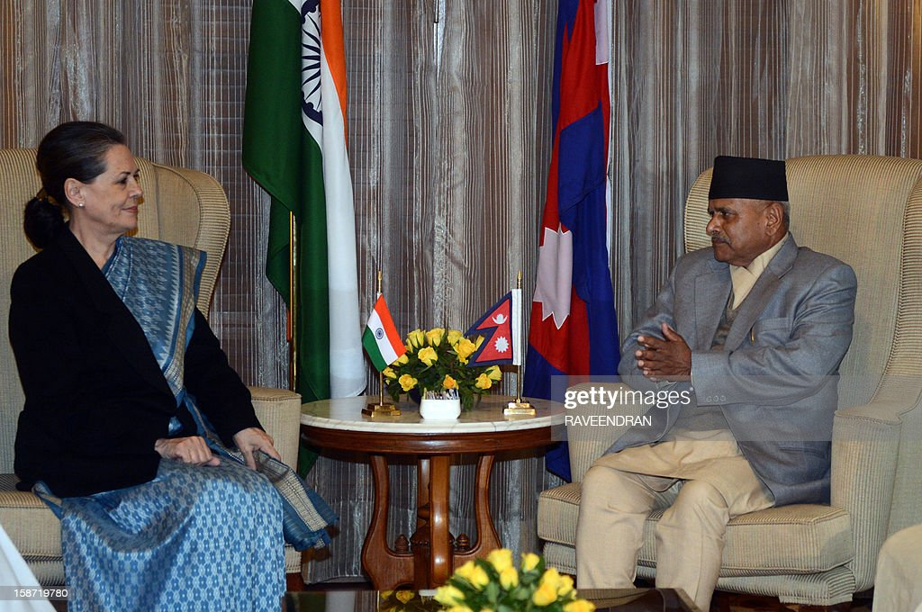 Nepal President Ram Baran Yadav (R) speaks with Chairperson of India's UPA Government, Sonia Gandhi during a meeting in New Delhi on December 26, 2012. Yadav is in India for a six-day official visit.