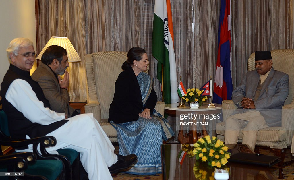 Nepal President Ram Baran Yadav (R) speaks with Chairperson of India's UPA Government, Sonia Gandhi (C) as as Indian Minister for External Affairs Salman Khurshid (L) and Indian Minister for Commerce and Industry, Anand Sharma (2L) look on during a meeting in New Delhi on December 26, 2012. Yadav is in India for a six-day official visit.