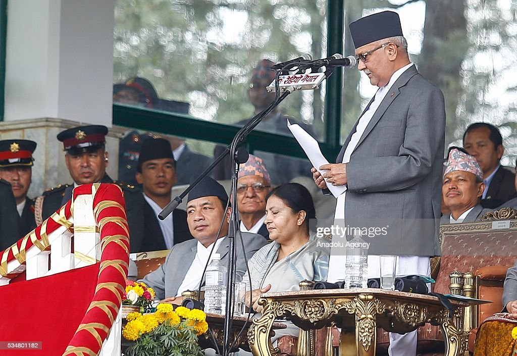 Nepal Prime Minister KP Sharma Oli (R) gives his speech in presents of Nepals President Bidhya Devi Bhandar (C) and Vice President Nanda Kishor Pune (L) during the 9th Republic Day parade in Kathmandu, Nepal on May 28, 2016.