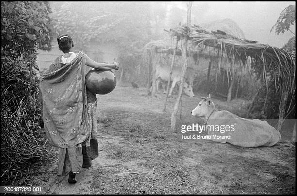 Nepal, Tera, Tharu woman, rear view (B&W)
