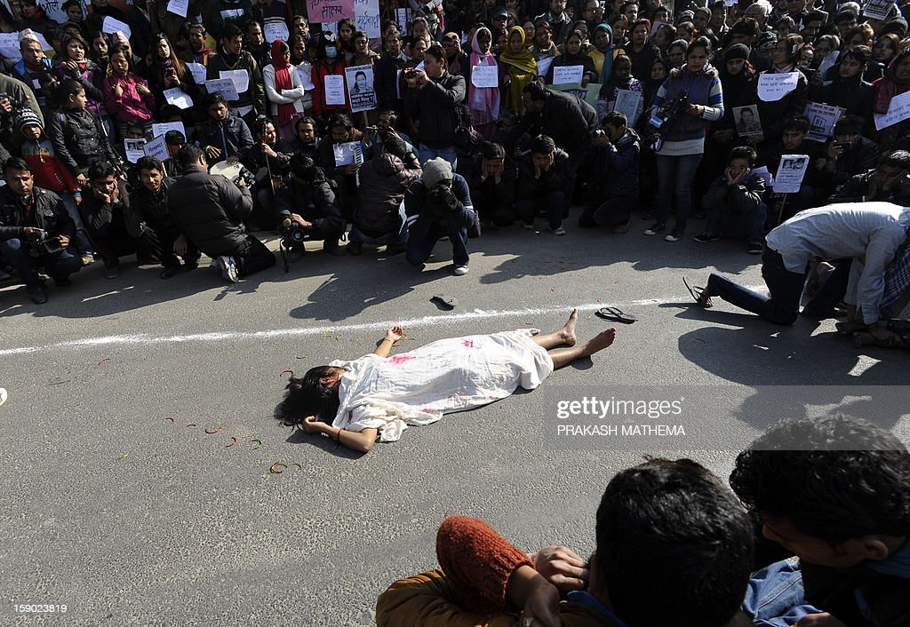 Nepalese activists perform a street drama during a protest near the Prime Minister's residence in Kathmandu on January 6, 2013, during a protest demanding justice in rising cases of violence against women. Hundreds of Nepalese campaigners have protested over the alleged rape and robbery of a maid by government officials, echoing widespread anger in neighbouring India over violence against women. AFP PHOTO/ Prakash MATHEMA