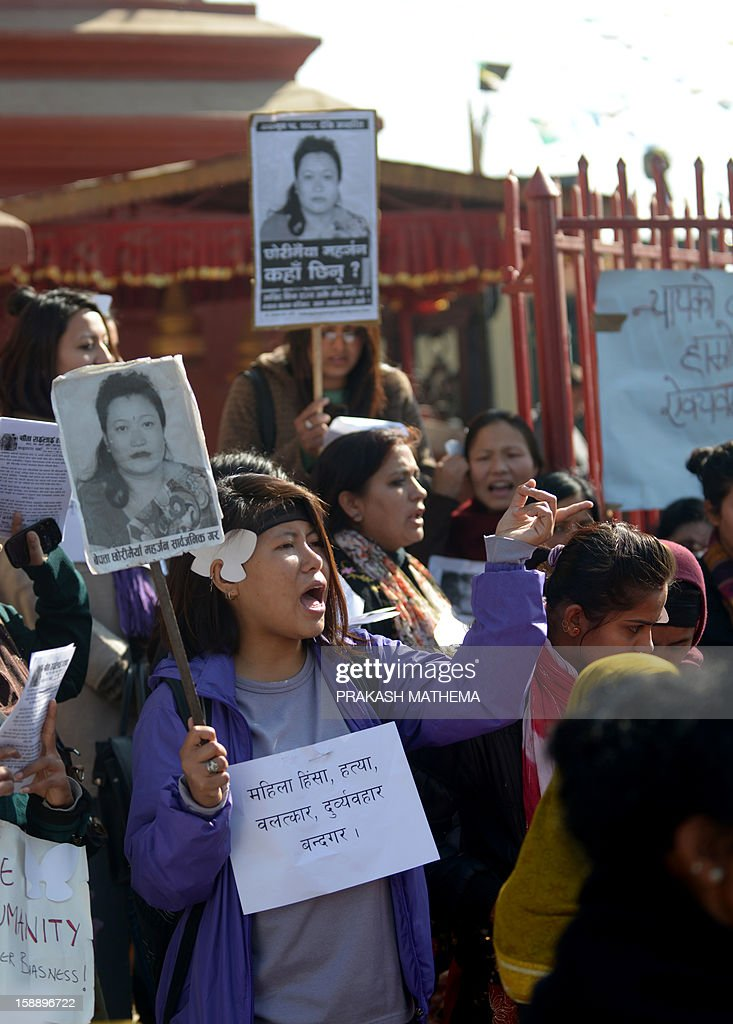 Nepalese activists shout slogans as they march near the Prime Minister's residence in Kathmandu on January 3, 2013, during a protest demanding justice in rising cases of violence against women. Hundreds of Nepalese campaigners have protested over the alleged rape and robbery of a maid by government officials, echoing widespread anger in neighbouring India over violence against women. AFP PHOTO/Prakash MATHEMA