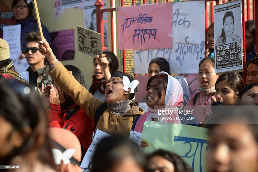 Nepalese activists shout slogans as they sit on protest near the Prime Minister's residence in Kathmandu on January 6, 2013, during a protest demanding justice in rising cases of violence against women. Hundreds of Nepalese campaigners have protested over the alleged rape and robbery of a maid by government officials, echoing widespread anger in neighbouring India over violence against women. AFP PHOTO/Prakash MATHEMA
